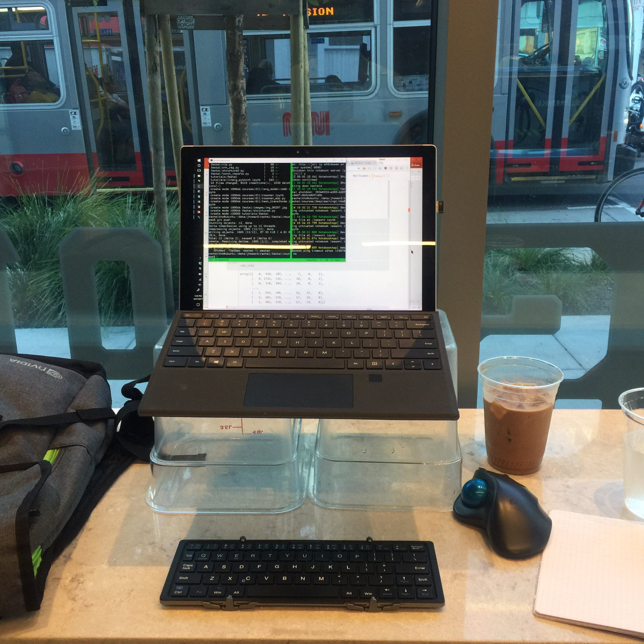 The barista at this coffee shop kindly let me use 2 plastic tubs to prop up my laptop.