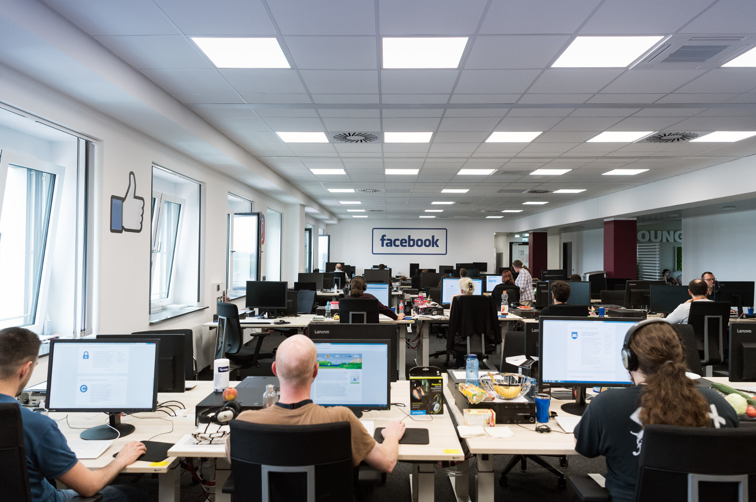 photo of inside of Facebook's Moderation Center in Berlin from https://www.thelocal.de/20170711/the-first-beheading-video-made-me-weep-a-day-in-the-life-of-facebook-moderators