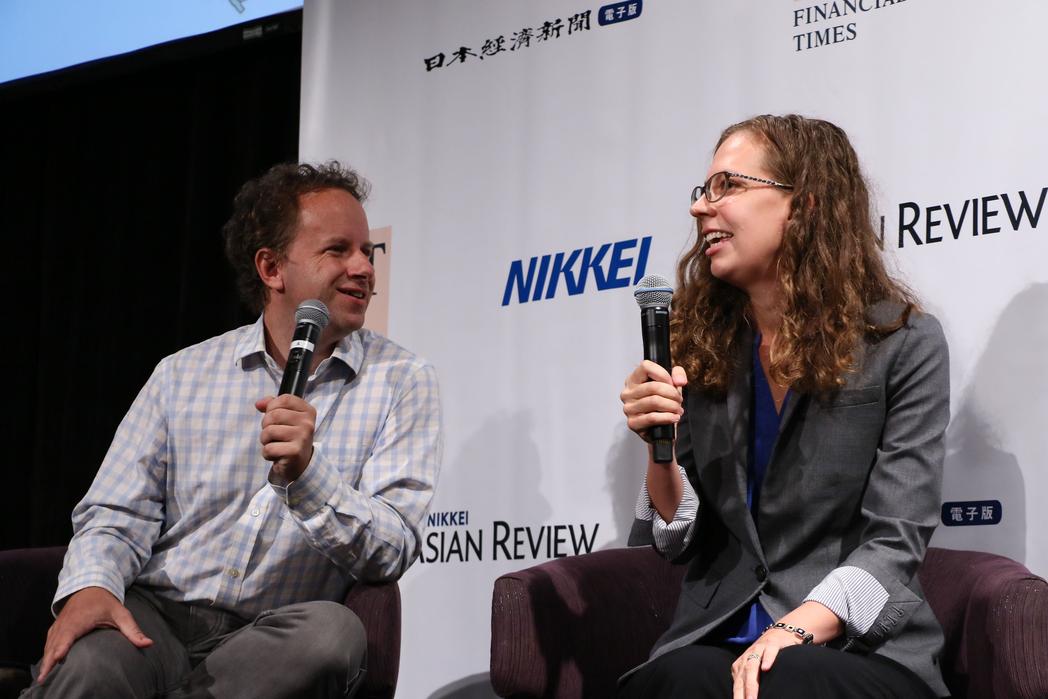fast.ai founders Jeremy and Rachel speaking at the Nikkei Innovation Forum